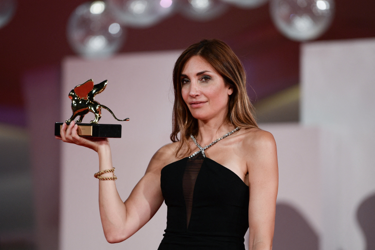 French director Audrey Diwan poses with the Golden Lion for Best Film she received for LEvenement (Happening) during the Winners Photocall following the closing ceremony of the 78th Venice Film Festival on September 11, 2021 at Venice Lido. (Photo by Filippo MONTEFORTE / AFP)